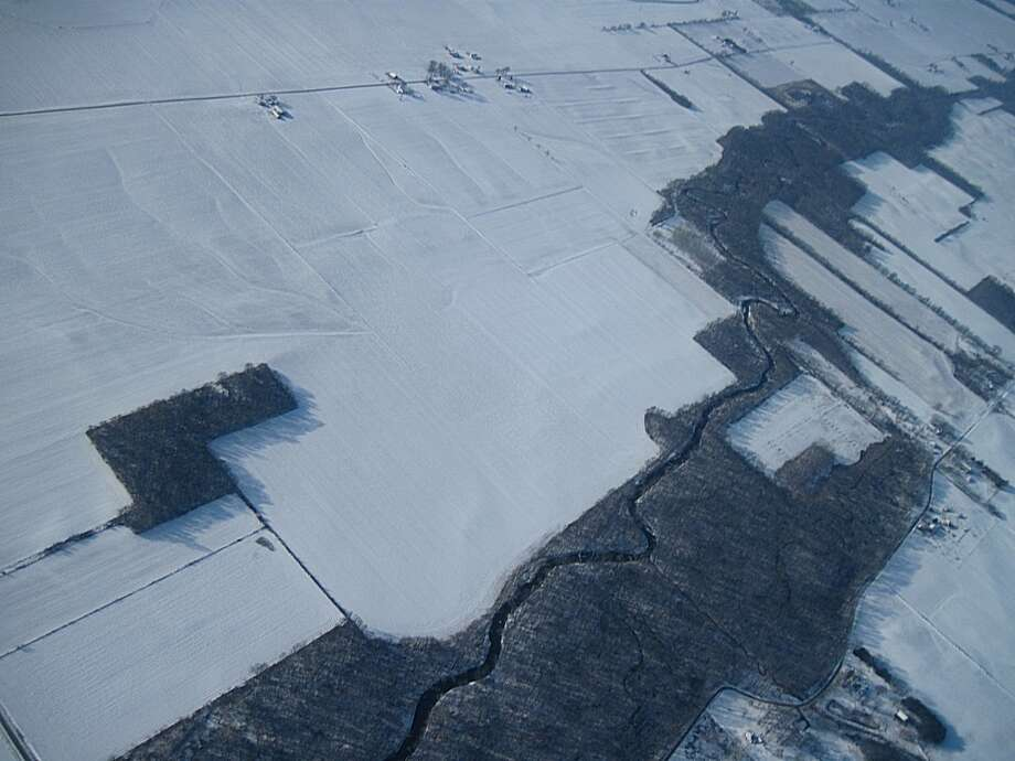 This photo provided by John Flaig via The Kokomo Tribune last Sunday shows an image taken from a high altitude weather balloon as it parachuted down in Lincoln, Ind. off Indiana 35. Flaig, a 38-year-old computer programmer from Milwaukee, Wis., launched the balloon at around 6 a.m. on a frigidly cold Sunday from a public park in Mendota, Ill. Photo: AP