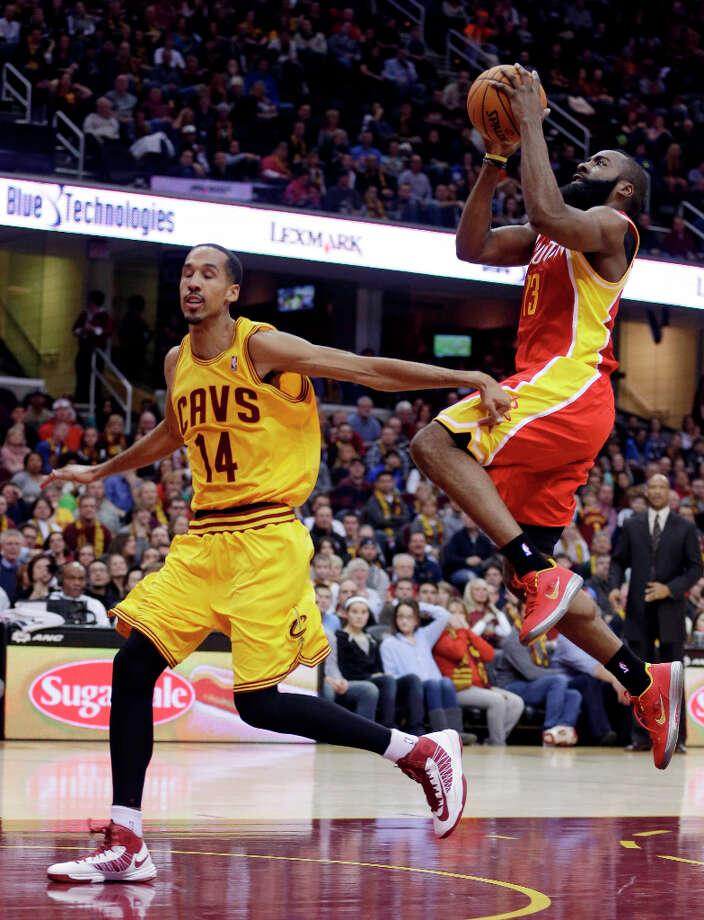 Jan. 5: Rockets 112, Cavaliers 104James Harden jumps to the basket next to Shaun Livingston. Photo: Tony Dejak, Associated Press / AP