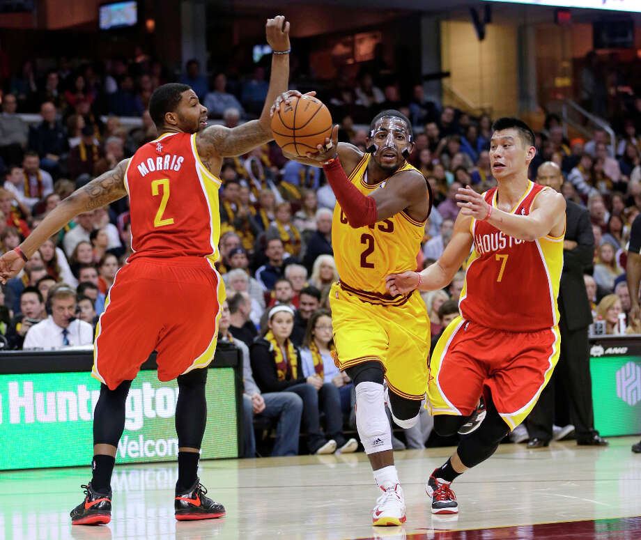 Kyrie Irving (2) drives between Marcus Morris (2) and Jeremy Lin (7). Photo: Tony Dejak, Associated Press / AP