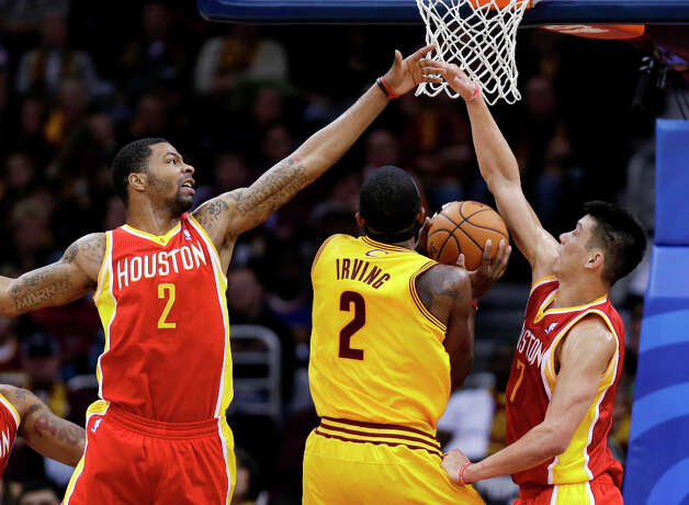 Marcus Morris (2) and Jeremy Lin (7) block Kyrie Irving (2) from shooting. Photo: Tony Dejak, Associated Press / AP