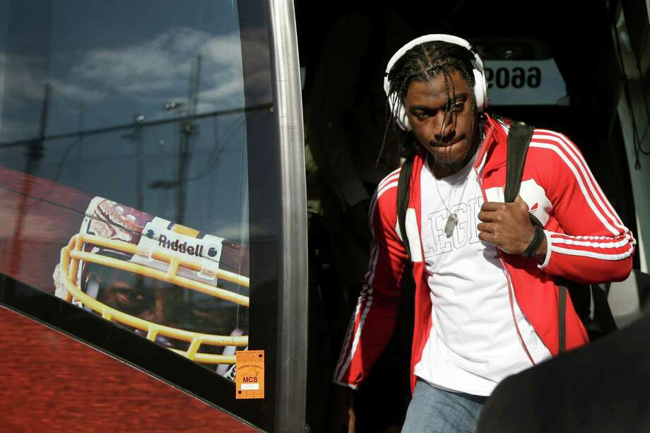 Washington Redskins quarterback Robert Griffin III steps off the team bus before an NFL wild card playoff football game against the Seattle Seahawks in Landover, Md., Sunday, Jan. 6, 2013. Photo: AP