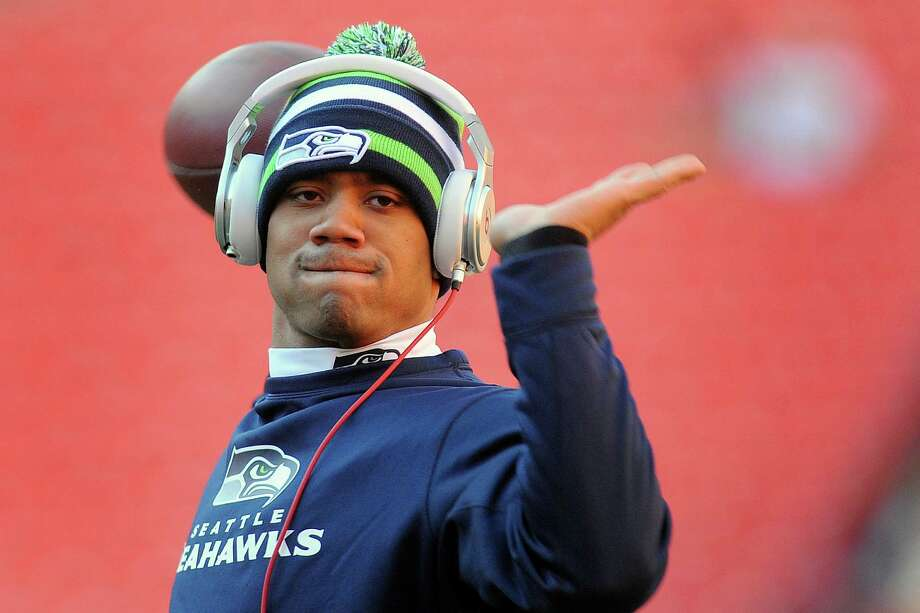 Seattle Seahawks quarterback Russell Wilson warms up before an NFL wild card playoff football game against the Washington Redskins in Landover, Md., Sunday, Jan. 6, 2013. Photo: AP