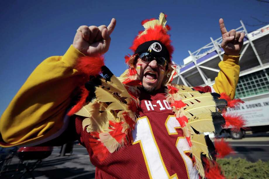 Washington Redskins fan Dave Lysinger poses for photographers in the parking lot of FedEx Field before an NFL wild card playoff football game against the Seattle Seahawks in Landover, Md., Sunday, Jan. 6, 2013. Photo: AP