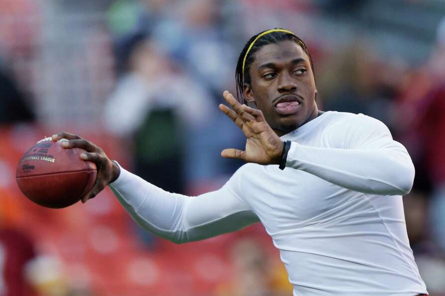 Washington Redskins quarterback Robert Griffin III warms up before an NFL wild card playoff football