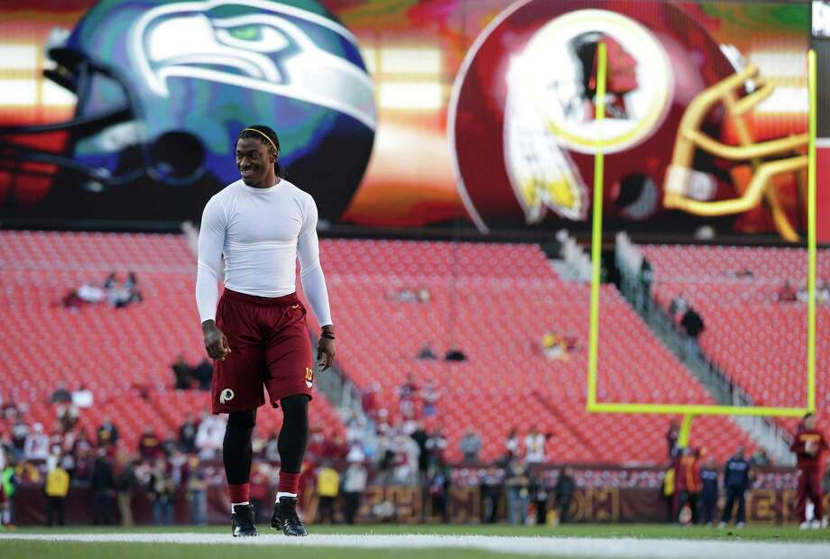 Washington Redskins quarterback Robert Griffin III walks onto the field before an NFL wild card playoff football game against the Seattle Seahawks in Landover, Md., Sunday, Jan. 6, 2013. Photo: AP