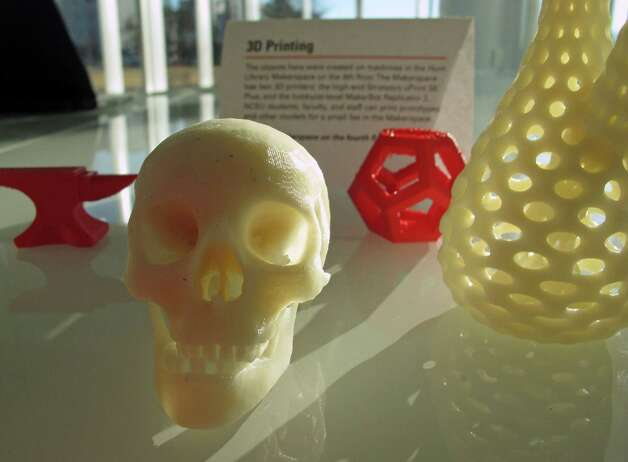 Tiny objects produced by a 3D printer sit on a table at the newly opened James B. Hunt Jr. Library at North Carolina State University in Raleigh on Friday. The printer, an automated book retrieval system and walls that double as video screens are among the many innovations in the new, state-of-the-art facility. Photo: AP