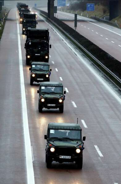 Army trucks  drive on highway A20 near Vietow , eastern Germany  on their way to Luebeck-Travemuende