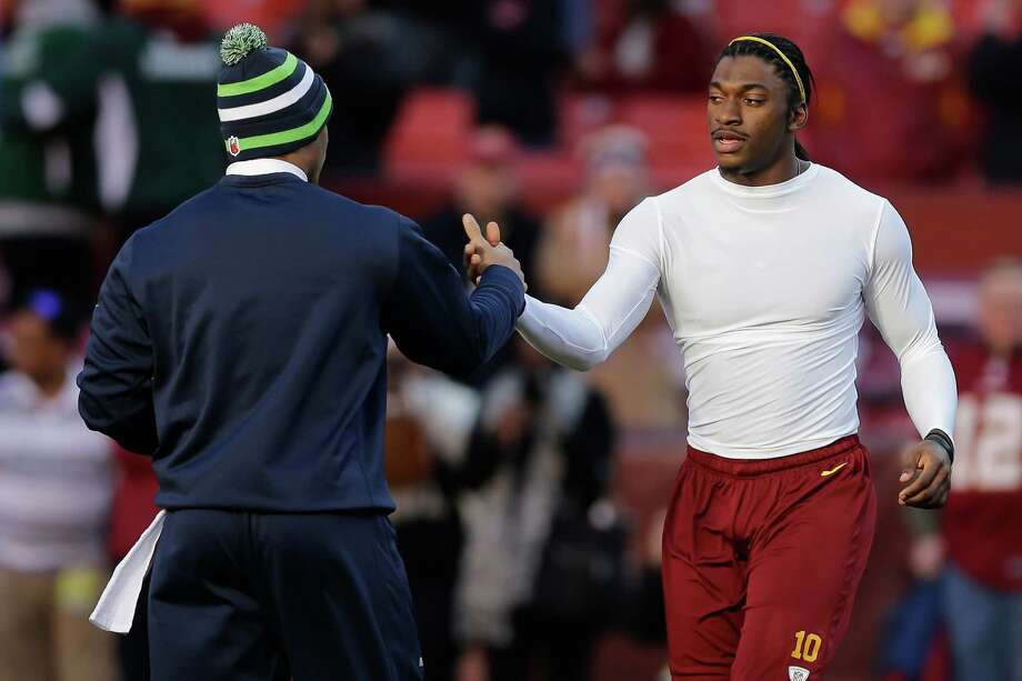 Seattle Seahawks quarterback Russell Wilson, left, greats Washington Redskins quarterback Robert Griffin III before an NFL wild card playoff football game in Landover, Md., Sunday, Jan. 6, 2013. Photo: AP