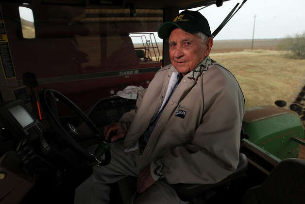 Farmer Jack Chiodo sits inside a tractor he uses for farming in his barn near Dilley, Texas on Friday, Jan. 4, 2013. Chiodo, a 1939 graduate from Brackenridge High School and retired Air Force pilot, started farming in 1965. His business in growing peanuts, corn, wheat, cabbage, green beans and sorghum has blossomed into his twilight years. Chiodo, 91, will eventually hand over the business to his daughter. Photo: Kin Man Hui, San Antonio Express-News / © 2012 San Antonio Express-News