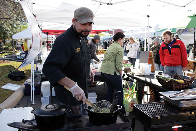 Señor Veggie Chef/Owner Jose Alfredo Cruz fries up falafel at the Alamo Quarry Farmer's Market, Sunday, Jan. 6, 2013. The City of San Antonio has added new regulations making it more difficult for farmers market booths to cook and sell food on-site. Photo: Jerry Lara, San Antonio Express-News / © 2012 San Antonio Express-News
