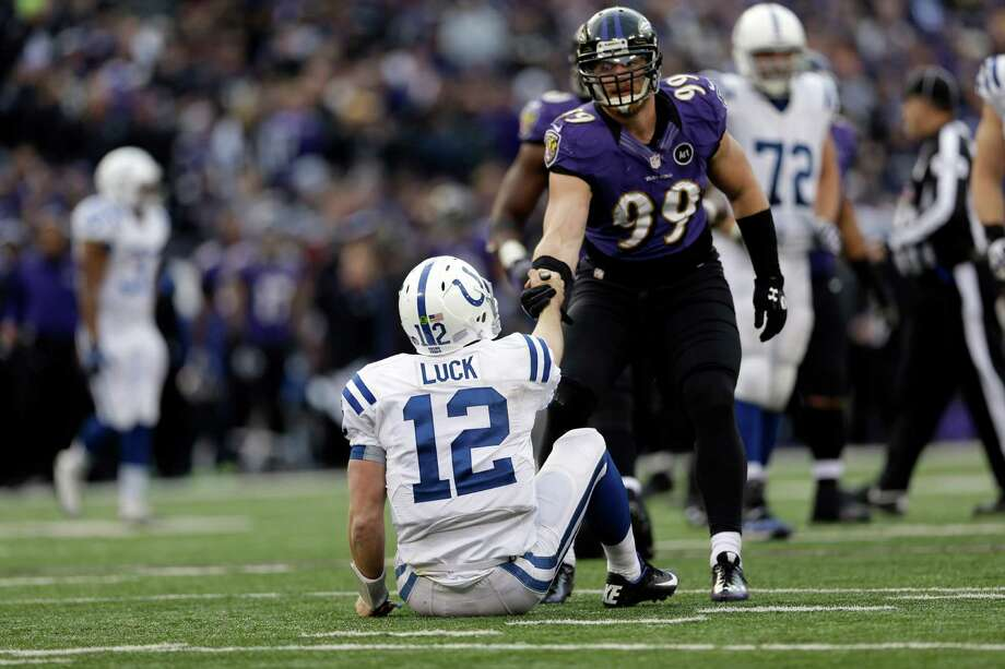 Indianapolis Colts quarterback Andrew Luck (12) is helped up by Baltimore Ravens outside linebacker Paul Kruger (99) during the second half of an NFL wild card playoff football game Sunday, Jan. 6, 2013, in Baltimore. The Ravens won 24-9. (AP Photo/Patrick Semansky) Photo: Patrick Semansky, STF / AP