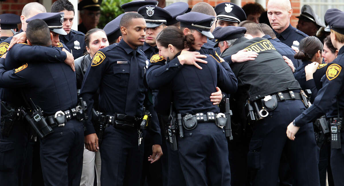 San Antonio police officers embrace after the funeral service for officer Edrees Mukhtar at Porter Loring Mortuary Wednesday January 2, 2013. Mukhtar,28, had been hospitalized since a December 10 car crash and died Saturday evening. Mukhtar had been with the police department for 18 months.