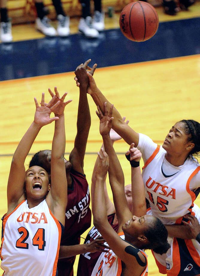A trio of UTSA Roadrunners, Ashley Spaletta (24), Niaga Mitchell-Cole (12) and Simone Young (15) battle for a rebound against NMSU during Western Athletic Conference action at the UTSA Convocation Center on Thursday, Jan. 3, 2013. Photo: Billy Calzada, San Antonio Express-News / SAN ANTONIO EXPRESS-NEWS