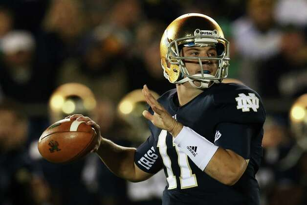 Quarterback Tommy Rees #11 of the Notre Dame Fighting Irish looks to pass against the Michigan Wolverines in the third quarter at Notre Dame Stadium on September 22, 2012 in South Bend, Indiana.  (Photo by Jonathan Daniel/Getty Images) Photo: Jonathan Daniel, EN / 2012 Getty Images