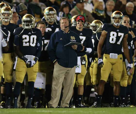 Head coach Brian Kelly of the Notre Dame Fighting Irish watches along with his team as the Irish take on the Michigan Wolverines at Notre Dame Stadium on September 22, 2012 in South Bend, Indiana. (Photo by Jonathan Daniel/Getty Images) Photo: Jonathan Daniel, EN / 2012 Getty Images