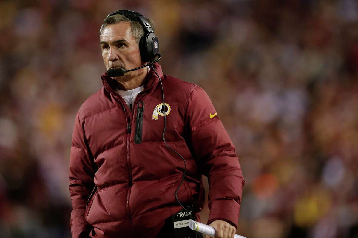 Washington Redskins head coach Mike Shanahan watches the action on the field during the first half of an NFL wild card playoff football game against the Seattle Seahawks in Landover, Md., Sunday, Jan. 6, 2013.