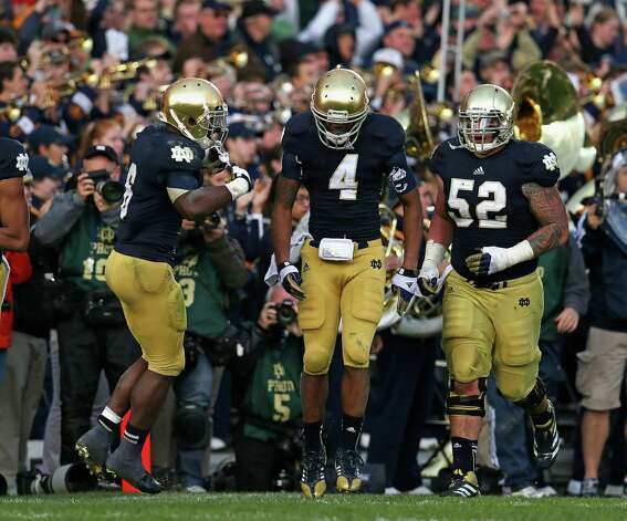 George Atkinson III #4 of the Notre Dame Fighting Irish celebrates scoring the winning touchdown with Theo Riddick #6 and Braxston Cave #52 against the BYU Cougars at Notre Dame Stadium on October 20, 2012 in South Bend, Indiana. Notre Dame defeated BYU 17-14. Photo: Jonathan Daniel, Getty Images / 2012 Getty Images