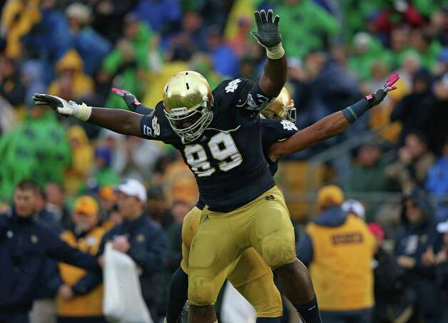 Kapron Lewis-Moore #89 and Matthias Farley #41 of the Notre Dame Fighting Irish celebrate a blocking field goal against the Standford Cardinal at Notre Dame Stadium on October 13, 2012 in South Bend, Indiana. Photo: Jonathan Daniel, Getty Images / 2012 Getty Images