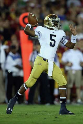 Quarterback Everett Golson #5 of the Notre Dame Fighting Irish drops back to pass against the USC Trojans in the first half at Los Angeles Memorial Coliseum on November 24, 2012 in Los Angeles, California. Notre Dame defeated USC Trojans 22-13. Photo: Jeff Gross, Getty Images / 2012 Getty Images