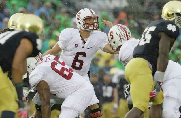 Stanford quarterback Josh Nunes (6) talks to teammates during the first half of an NCAA college football game against Notre Dame in South Bend, Ind., Saturday, Oct. 13, 2012. (AP Photo/Nam Y. Huh) Photo: Nam Y. Huh, Associated Press / AP