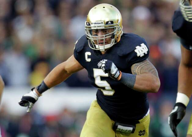 FILE - In this Oct. 20, 2012, file photo, Notre Dame linebacker Manti Te'o chases the action during the second half of an NCAA college football game against the BYU in South Bend, Ind. Te'o is a finalist for the Heisman Trophy. (AP Photo/Michael Conroy, File) Photo: Michael Conroy, Associated Press / AP