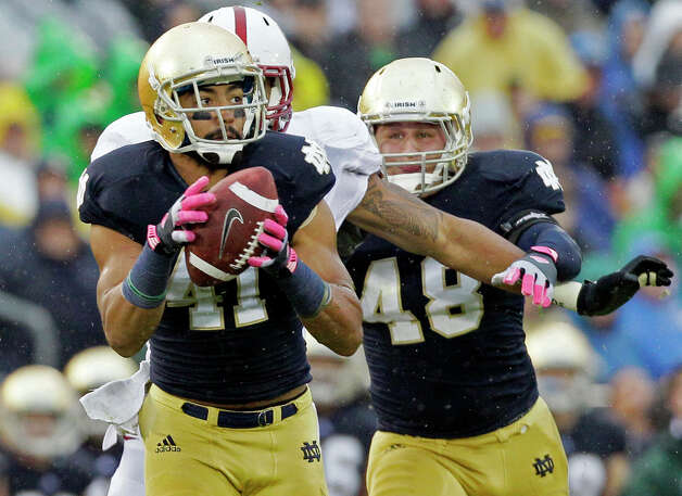 FILE - In this Oct. 13, 2012, file photo, Notre Dame safety Matthias Farley (41) intercepts a pass past Stanford tight end Levine Toliolo (11) during the first half of an NCAA college football game in South Bend, Ind. Farley was a soccer player before transitioning to football, first as a wide receiver and now a starting safety for No. 1 Notre Dame.  (AP Photo/Nam Y. Huh, File) Photo: Nam Y. Huh, Associated Press / AP