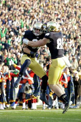 Notre Dame wide receiver John Goodman, left, celebrates with tight end Troy Niklas after scoring a touchdown against Wake Forest during the first half of an NCAA college football game in South Bend, Ind., Saturday, Nov. 17, 2012. (AP Photo/Michael Conroy) Photo: Michael Conroy, Associated Press / AP