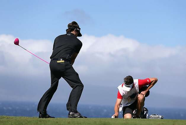 Bubba Watson pretends to tee off as caddie Ted Scott serves as holder. The field goal was no good. Photo: Christian Petersen, Getty Images