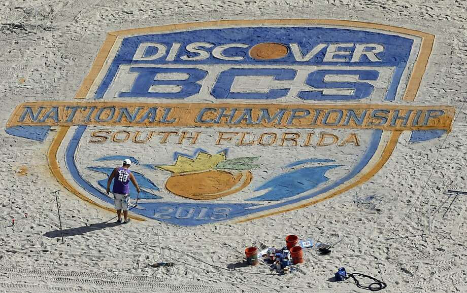 Life's a beach for the this Bowl Championship Series logo in Fort Lauderdale, Fla., roughly 20 miles from Sun Life Stadium, the home of the BCS title game. Photo: Chris O'Meara, Associated Press
