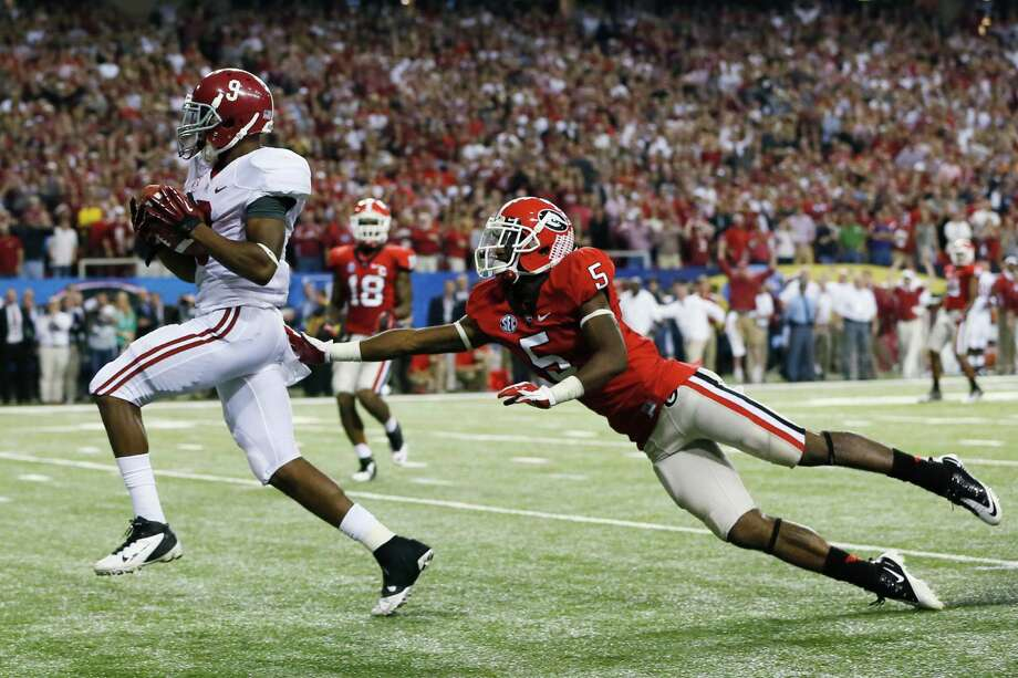 Wide receiver Amari Cooper #9 of the Alabama Crimson Tide catches a fourth quarter touchdown pass in front of defensive back Damian Swann #5 of the Georgia Bulldogs during the SEC Championship Game at the Georgia Dome on December 1, 2012 in Atlanta, Georgia.  (Photo by Kevin C. Cox/Getty Images) Photo: Kevin C. Cox, EN / 2012 Getty Images