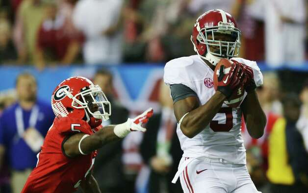Wide receiver Amari Cooper #9 of the Alabama Crimson Tide catches a fourth quarter touchdown pass in front of defensive back Damian Swann #5 of the Georgia Bulldogs during the SEC Championship Game at the Georgia Dome on December 1, 2012 in Atlanta, Georgia.  (Photo by Mike Ehrmann/Getty Images) Photo: Mike Ehrmann, EN / 2012 Getty Images