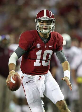 Quarterback AJ McCarron #10 of the Alabama Crimson Tide runs during the game against the Texas A&M Aggies at Bryant-Denny Stadium on November 10, 2012 in Tuscaloosa, Alabama.  (Photo by Mike Zarrilli/Getty Images) Photo: Mike Zarrilli, EN / 2012 Getty Images