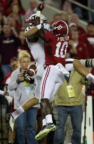 Cornerback John Fulton #10 of the Alabama Crimson Tide breaks up a pass to wide receiver Mike Evans #13 of the Texas A&M Aggies during the game at Bryant-Denny Stadium on November 10, 2012 in Tuscaloosa, Alabama.  (Photo by Mike Zarrilli/Getty Images) Photo: Mike Zarrilli, EN / 2012 Getty Images