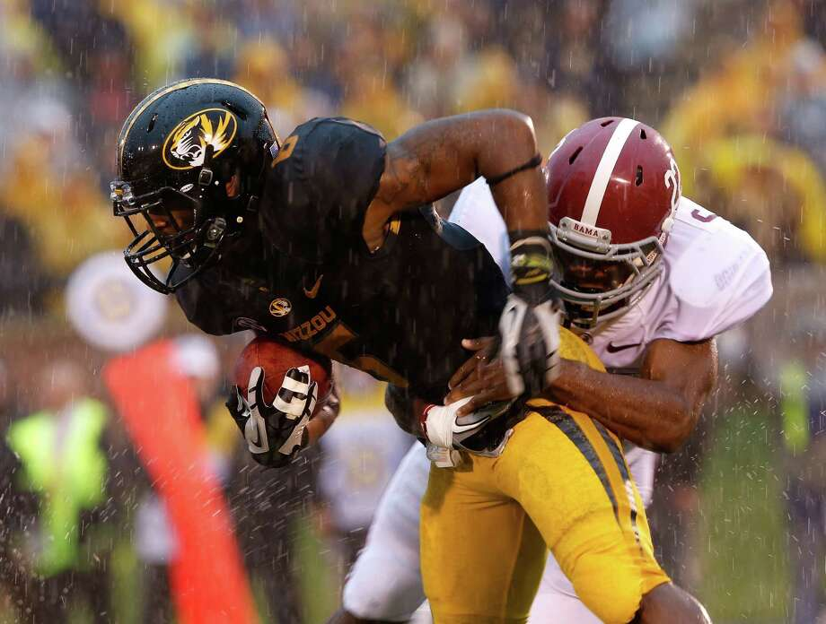 Wide receiver Rolandis Woodland #5 of the Missouri Tigers carries the ball as defensive back Hunter Bush #22 of the Alabama Crimson Tide defends during the game at Faurot Field/Memorial Stadium on October 13, 2012 in Columbia, Missouri.  (Photo by Jamie Squire/Getty Images) Photo: Jamie Squire, EN / 2012 Getty Images