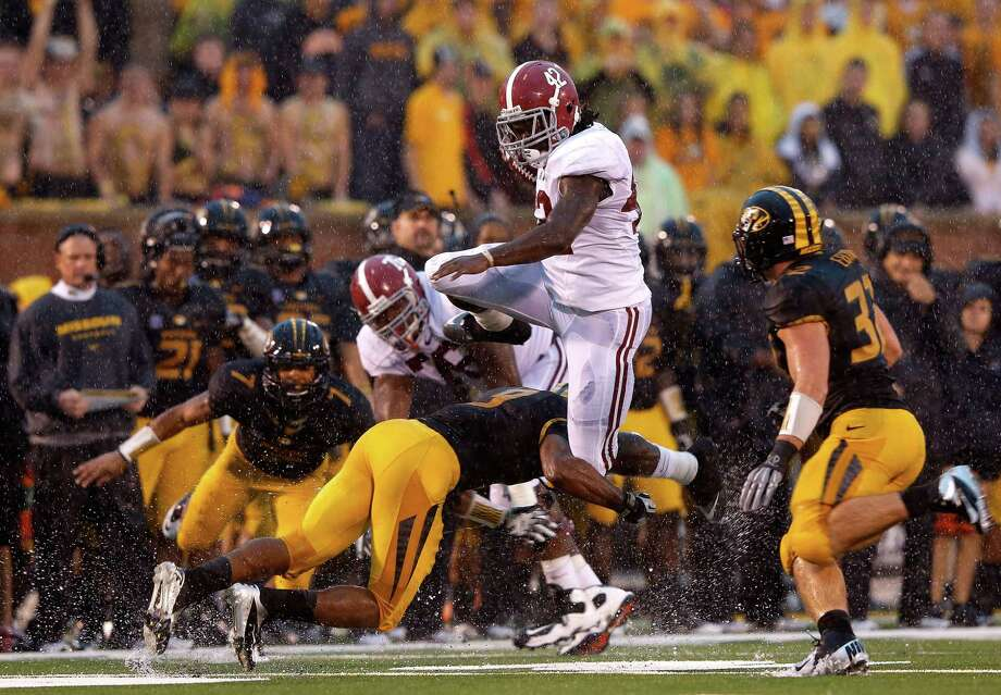 Running back Eddie Lacy #42 of the Alabama Crimson Tide leaps over defenders as he carries the ball upfield during the game against the Missouri Tigers at Faurot Field/Memorial Stadium on October 13, 2012 in Columbia, Missouri.  (Photo by Jamie Squire/Getty Images) ***BESTPIX*** Photo: Jamie Squire, EN / 2012 Getty Images