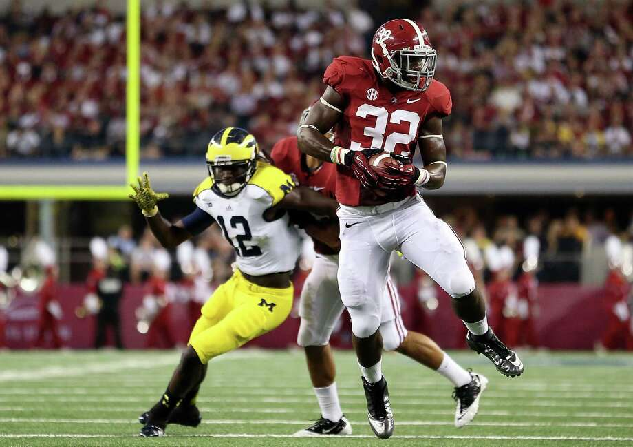 C.J. Mosley #32 of the Alabama Crimson Tide makes an interception against the Michigan Wolverines at Cowboys Stadium on September 1, 2012 in Arlington, Texas.  (Photo by Ronald Martinez/Getty Images) Photo: Ronald Martinez, EN / 2012 Getty Images