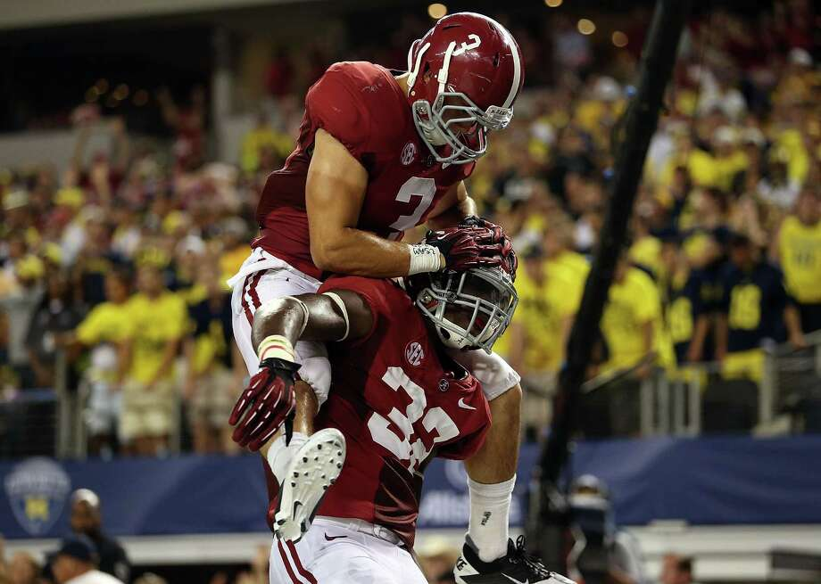 C.J. Mosley #32 of the Alabama Crimson Tide celebrates a touchdown interception with Vinnie Sunseri #3 against the Michigan Wolverines at Cowboys Stadium on September 1, 2012 in Arlington, Texas.  (Photo by Ronald Martinez/Getty Images) Photo: Ronald Martinez, EN / 2012 Getty Images