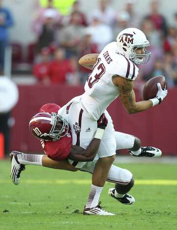 Texas A&M wide receiver Mike Evans (13) makes a catch as Alabama defensive back John Fulton (10) tries to bring him down during the second quarter of a college football game at Bryant-Denny Stadium, Saturday, Nov. 10, 2012, in Tuscaloosa. Photo: Karen Warren, EN / © 2012  Houston Chronicle