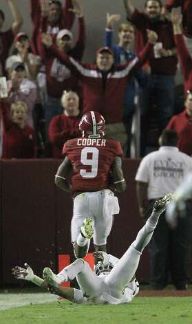 Alabama wide receiver Amari Cooper (9) makes it into the end zone as Howard Matthews (31) falls behind him for the touchdown during the second half of a college football game at Bryant-Denny Stadium, Saturday, Nov. 10, 2012, in Tuscaloosa. Photo: Karen Warren, EN / © 2012  Houston Chronicle