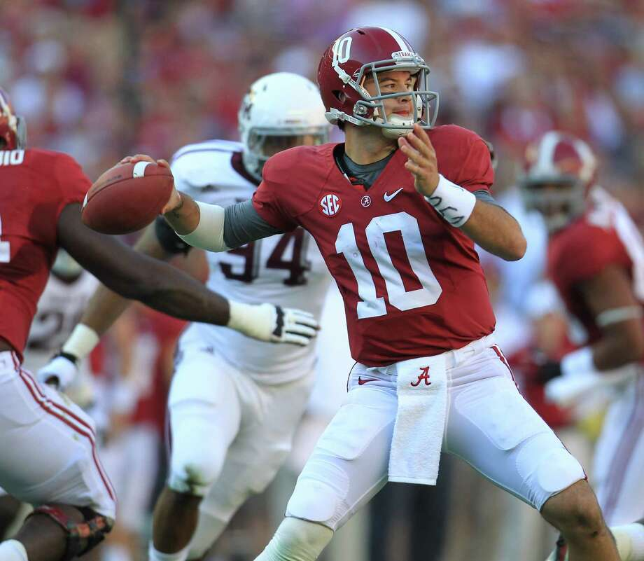 Alabama quarterback AJ McCarron (10) drips back to pass during the first quarter of a college football game at Bryant-Denny Stadium, Saturday, Nov. 10, 2012, in Tuscaloosa. Photo: Karen Warren, EN / © 2012  Houston Chronicle