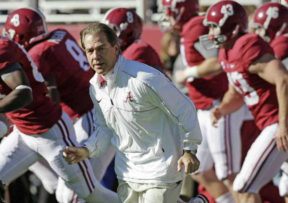 Alabama coach Nick Saban leads the Crimson Tide on the field before a NCAA college football game against Auburn at Bryant-Denny Stadium in Tuscaloosa, Ala., Saturday, Nov. 24, 2012. (AP Photo/Dave Martin) Photo: Dave Martin, EN / AP
