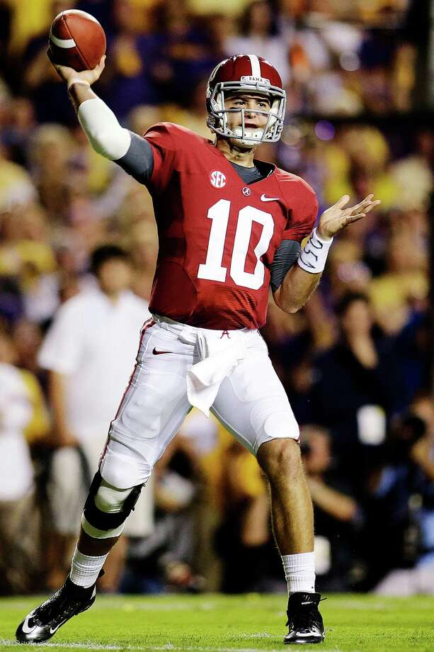 Alabama quarterback AJ McCarron (10) passes in the first half of their NCAA college football game against LSU in Baton Rouge, La., Saturday, Nov. 3, 2012. (AP Photo/Bill Haber) Photo: Bill Haber, Associated Press / FR170136 AP