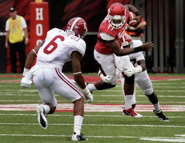 Arkansas quarterback Brandon Mitchell (17) tries to get past Alabama defensive back Ha'Sean Clinton-Dix (6) defensive back Nick Perry during the first quarter of an NCAA college football game in Fayetteville, Ark., Saturday, Sept. 15, 2012. (AP Photo/Danny Johnston) Photo: Danny Johnston, Associated Press / AP