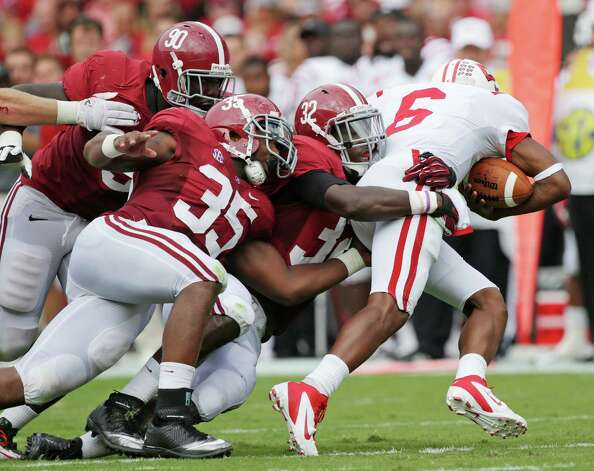 Alabama linebacker C.J. Mosley (32), Nico Johnson (35) and Quinton Dial (90) sack Western Kentucky quarterback Kawaun Jakes (6) in the first half of an NCAA college football game at Bryant Denny Stadium in Tuscaloosa, Ala., Saturday, Sept. 8, 2012. (AP Photo/Dave Martin) Photo: Dave Martin, Associated Press / AP
