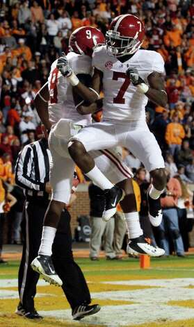 Alabama wide receiver Amari Cooper (9) and teammate Kenny Bell (7) celebrate a touchdown during the first quarter of an NCAA college football game  against Tennessee, Saturday, Oct. 20, 2012, in Knoxville, Tenn. (AP Photo/Wade Payne) Photo: Wade Payne, Associated Press / FR23601 AP