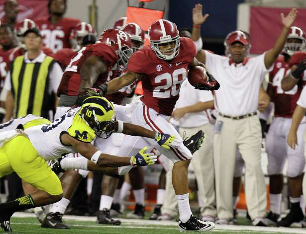 Alabama defensive back Dee Milliner (28) runs back a turnover past Michigan wide receiver Jeremy Gallon (10) during in the first half of an NCAA college football game at Cowboys Stadium in Arlington, Texas, Saturday, Sept. 1, 2012.  (AP Photo/LM Otero) Photo: LM Otero, Associated Press / AP