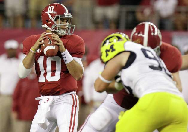 Alabama quarterback AJ McCarron (10) during the first half of the NCAA college football game against  Michigan at Cowboys Stadium in Arlington, Texas, Saturday, Sept. 1, 2012. (AP Photo/LM Otero) Photo: LM Otero, Associated Press / AP
