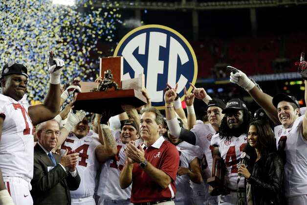 Alabama head coach Nick Saban and his players celebrate after their 32-28 win in the Southeastern Conference championship NCAA college football game against Georgia, Saturday, Dec. 1, 2012, in Atlanta. (AP Photo/David Goldman) Photo: David Goldman, Associated Press / AP