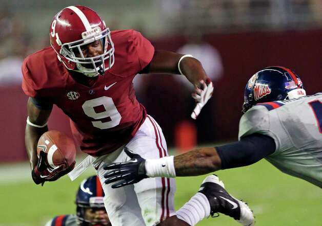 FILE - In this file photo taken Sept. 29, 2012, Alabama wide receiver Amari Cooper (9) stiffs arm out of the tackle of Mississippi linebacker Denzel Nkemdiche (4) during their NCAA college football game in Tuscaloosa, Ala. (AP Photo/Dave Martin, file) Photo: Dave Martin, Associated Press / AP