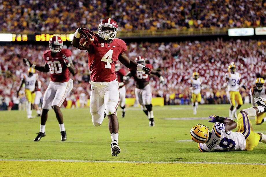 Alabama running back T.J. Yeldon (4) scores the winning touchdown past LSU defensive end Barkevious Mingo (49) in the second half of their NCAA college football game in Baton Rouge, La., Saturday, Nov. 3, 2012. Alabama won 21-17. (AP Photo/Gerald Herbert) Photo: Gerald Herbert, Associated Press / AP